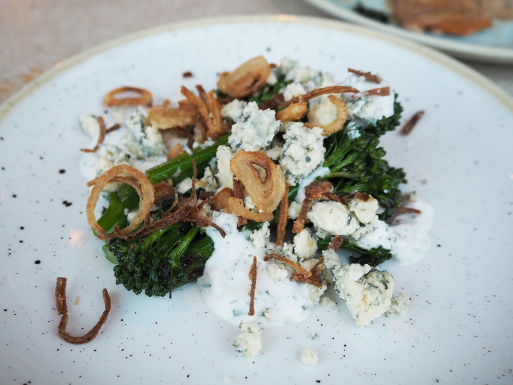 Duck and Waffle tenderstem broccoli with blue cheese and crispy shallots